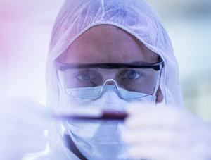 Close up image of scientist examining a sample