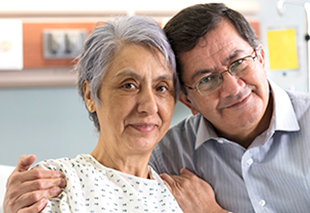 Image of husband and wife in hospital setting